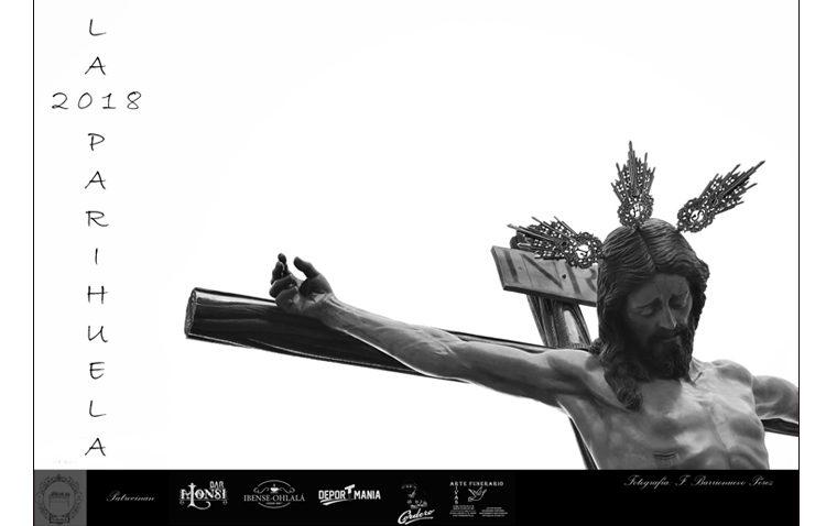 Una fotografía en blanco y negro del Cristo del Amor, imagen del cartel editado por la tertulia «La parihuela»