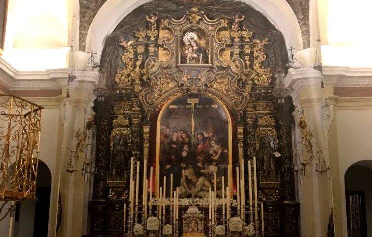 La empresa utrerana Ramsol crea y dona una lona para cubrir la restauración del retablo de la sevillana capilla del Baratillo