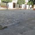 Colocación de adoquines en la calle Corredera